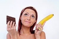 woman with chocolate and banana, sweet or vitamins