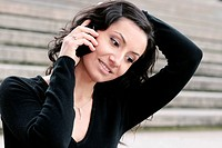 young darkhaired woman using her mobile