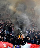 football, hooligans setting fire at stand