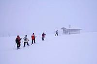 Snowshoe trekking at fell Pallas. Resting hut, Finland, Lapland