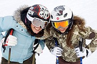 two girl_friends with ski helmet and ski goggles, France, Alps