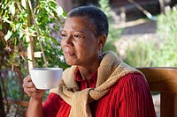 African woman drinking coffee