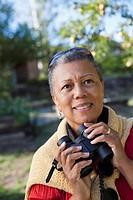 African woman holding binoculars