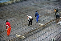 Laying concrete surface at a construction site for a housing complex, Essen, North Rhine_Westphalia, Germany, Europe