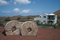 Spain, Lanzarote, Cactus garden, Millstones in foreground