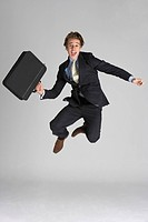 Businessman Jumping In Air