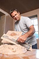 Plasterer Mixing Plaster