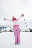 Italy, South Tyrol, Seiseralm, Woman holding ski poles