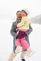 Italy, South Tyrol, Seiseralm, Father holding daughter 4_5 smiling, portrait, close_up