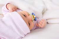 Baby girl 2 months with pacifier, portrait