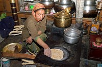 woman baking chapatis in the kitchen, Nurla, Indus valley, India, Ladakh