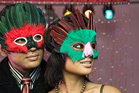 Couple wearing masquerade masks in a nightclub
