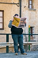 Man reading newspaper, Schignano, Val d´Intelvi Como, Italy