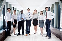 Business people standing in a row and posing together