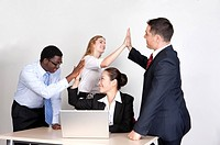 Business people having high_five and smiling happily