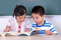 Child, Two children reading book together and learning