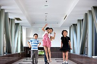 Child, Children jumping on the corridor with teacher standing behind
