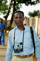 Local photographer with a camera around his neck, Douala, Cameroon, Africa