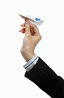 Human hand playing with paper airplane (thumbnail)