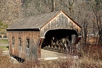 The Baltimore Covered Bridge during the autumn months    located in Springfield, Vermont USA which is part of scenic New England
