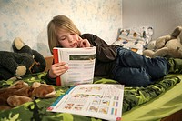 DEU, Germany: Young boy, student is learning for school, at home, Maths studies