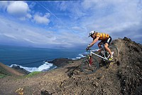 Man mountain biking, on a mountain bike tour, MTB tour, Fuerteventura, Canary Islands, Spain
