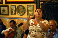 Mature woman singing at a restaurant, Casa de Anselma, Seville, Andalucia, Spain, Europe