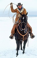 Cowboy roping with his lasso, Canada