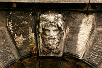 Stone face on a bridge in the town forest (Városliget), Budapest, Hungary, Europe