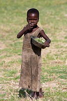little African girl in dirty wear, Namibia, Mahango National Park
