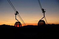 Passenger cabins of a cable car at sunset, South Tyrol, Italy, Europe