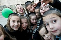 Orthodox Jewish boys having fun with the camera in the religious neighborhood of Mea Shearim in Jerusalem.