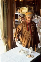 waiter serving tea,Al Bustan palace,Sultanate of Oman,Arabian Peninsula,Asia