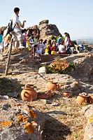 Clay jugs and tourists on rocks in the sunlight, Museum about the antique Sulki, Sant´Antioco, Sardinia, Italy, Europe