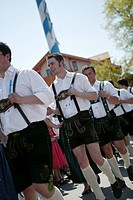 Young men in traditional bavarian clothes at 1st of May celebration, Muensing, bavaria, Germany