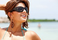 beach woman portrait in a bikini wearing sunglasses