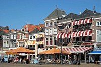 Pavement café with tourists on market square, Delft, the Netherlands