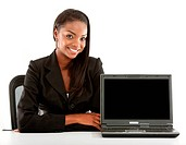 smiling young business woman sitting at a desk with a notebook turned to the camera