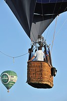 Balloonists / Aeronauts in basket of hot_air balloon during ballooning meeting, Eeklo, Belgium