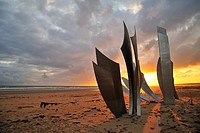 The Omaha Beach monument Les Braves on the beach at Saint_Laurent_sur_Mer at sunset, Normandy, France