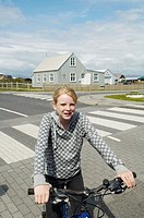 Iceland, Eyrarbakki village old houses, kids playing in the street with bicycle.