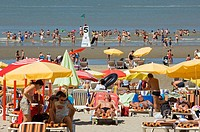Tourists sunbathing at the North Sea beach in summer, Blankenberge, Belgium