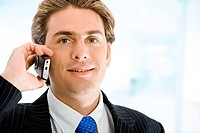 business man smiling and talking on a mobile phone