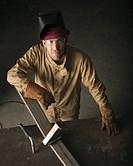 Steel worker in metal shop