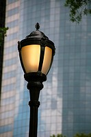 lamp in front of a high_rise building, USA, New York City