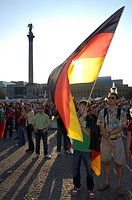 Football World Cup 2006: German Fans with flag, Stuttgart, Baden-Wuerttemberg, Germany