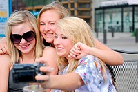 three young blond girlfriends making a self_portrait