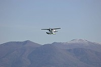 A floatplane and in the background the Chugach mountains Anchorage Alaska USA