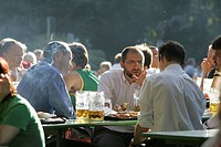 Munich, DEU, 05. Oct. 2005 _ People join the autumn sun at the famous beer garden namend Chinesischer Turm in Munich
