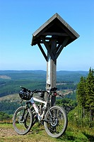 bicycles leaning at an information sign on a hill in the Sauerland, Germany, North Rhine_Westphalia